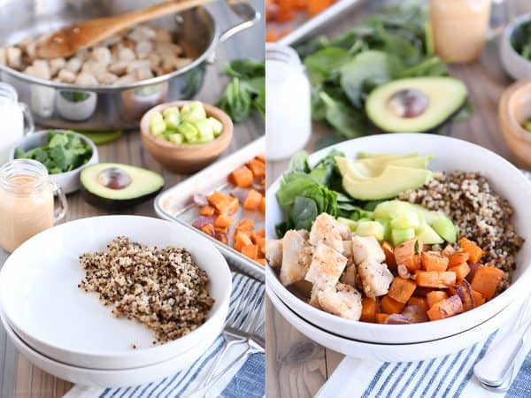Assembling Buddha bowls in white bowls with quinoa, chicken, sweet potatoes, avocado.
