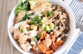 Landscape view Top down view of Buddha bowl recipe with peanut sauce.