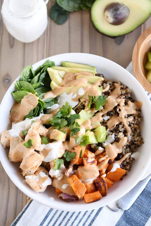 Top down view of Buddha bowl recipe with peanut sauce.