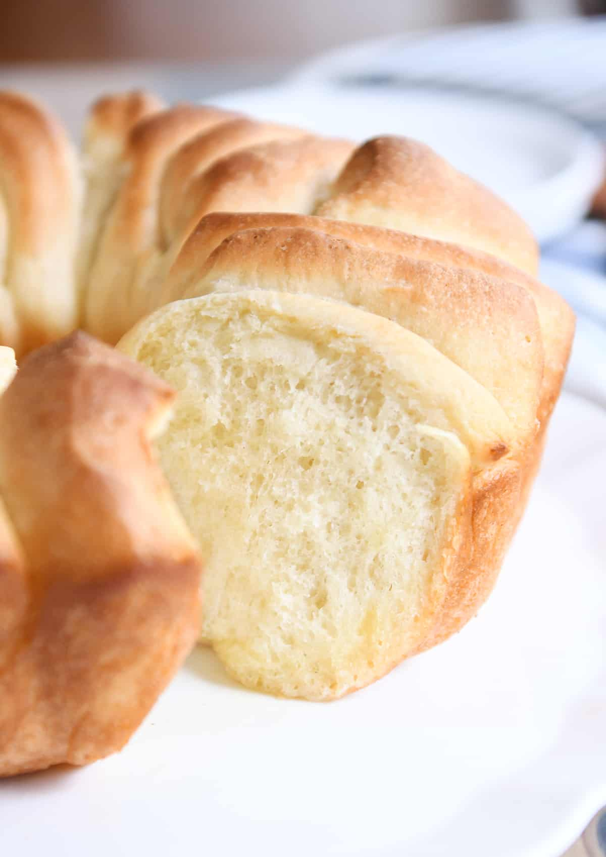Pull apart bundt bread on white platter.