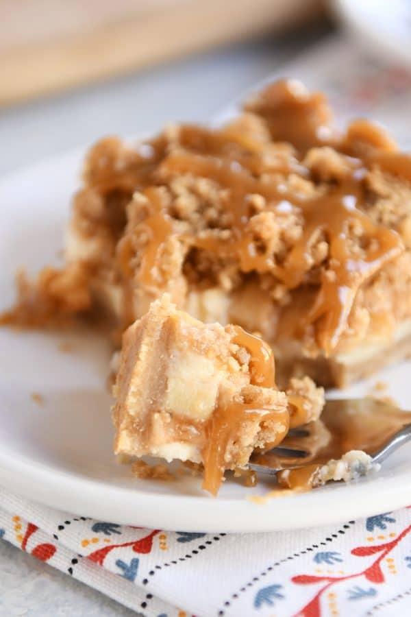 Forkful bite of caramel apple cheesecake bar.