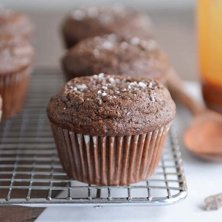 Double chocolate salted caramel muffin on cooling rack