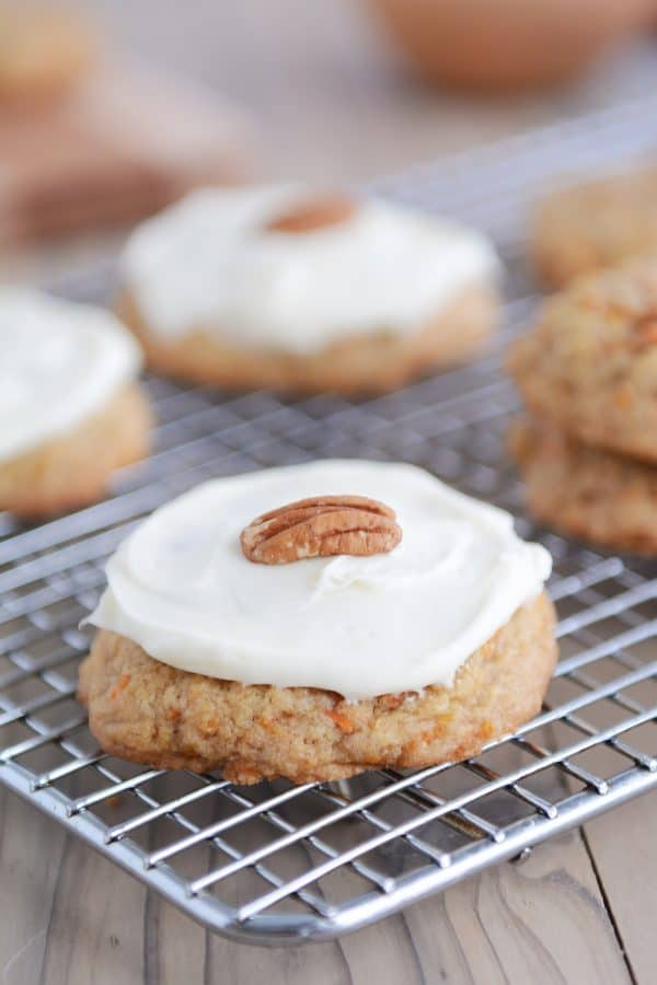 Frosted carrot cake cookie on cooling rack.