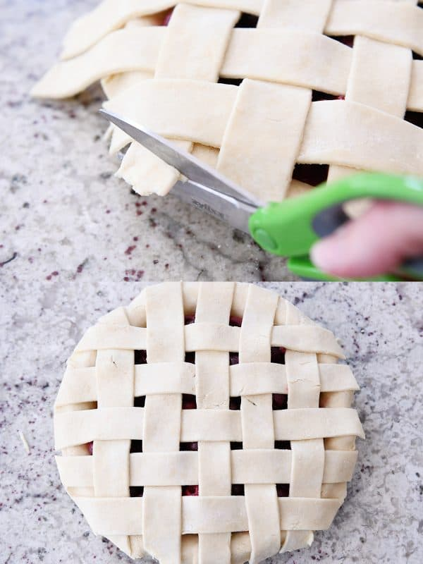 Trimming edges of cherry pie crust with kitchen scissors.