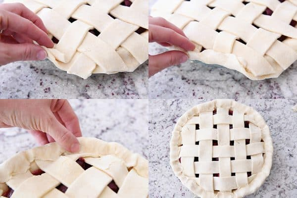 Folding over bottom edge of cherry pie crust to seal edges.