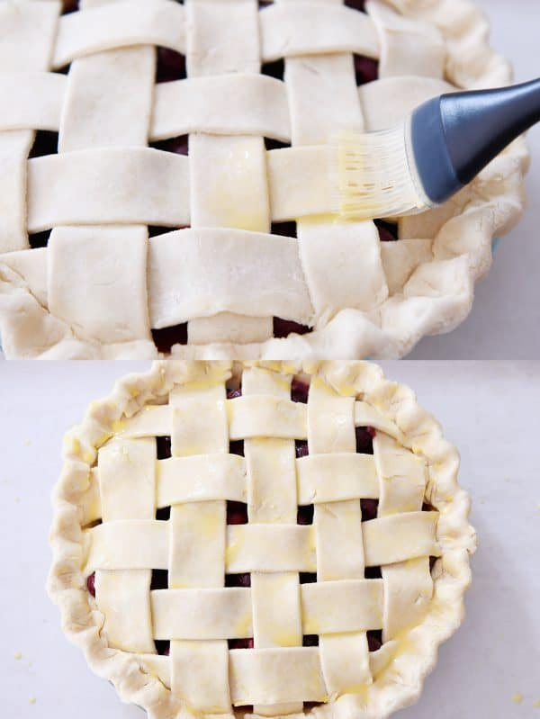Brushing beaten egg on top crust of cherry pie.
