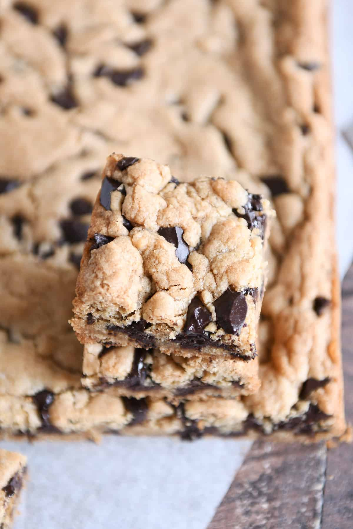 Two chocolate chip cookie bars stacked.