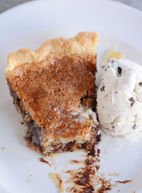 Top view of a slice of chocolate chip cookie pie with a bite taken out.