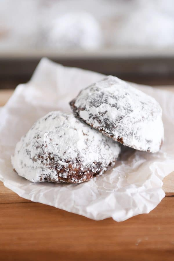 Two chocolate truffle cookies on a white napkin.