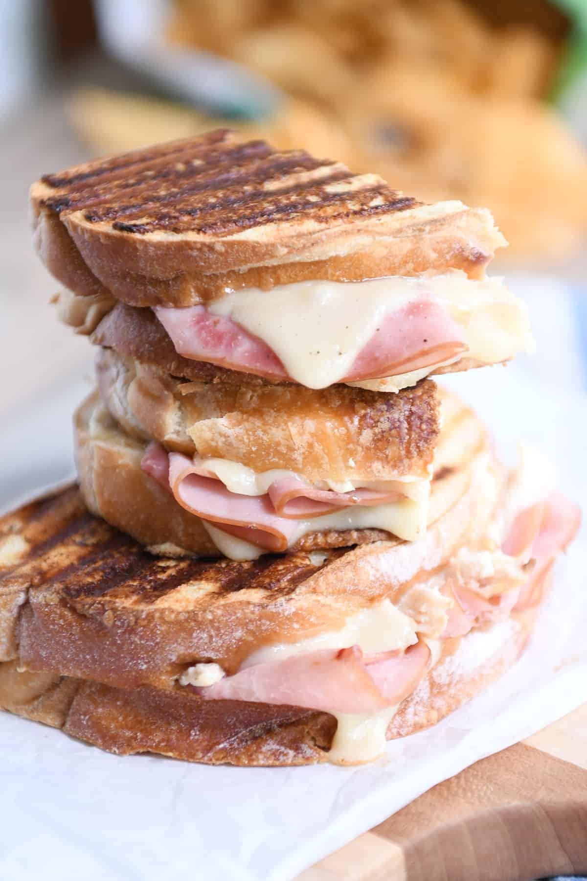 Three stacked chicken cordon bleu sandwiches.