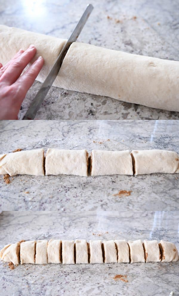 Cutting cinnamon roll log with serrated knife.