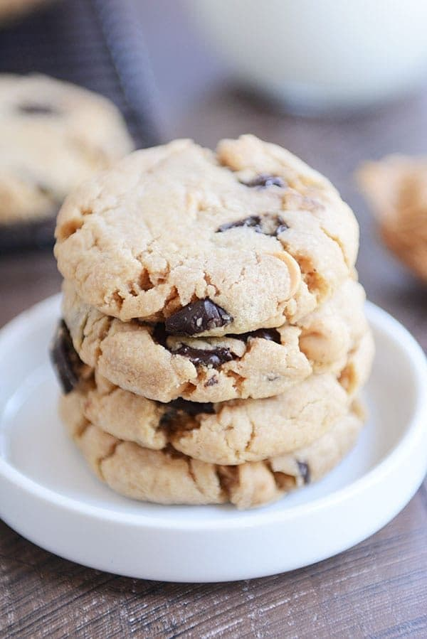 A stack of chocolate chip peanut butter cookies in a white ramekin.