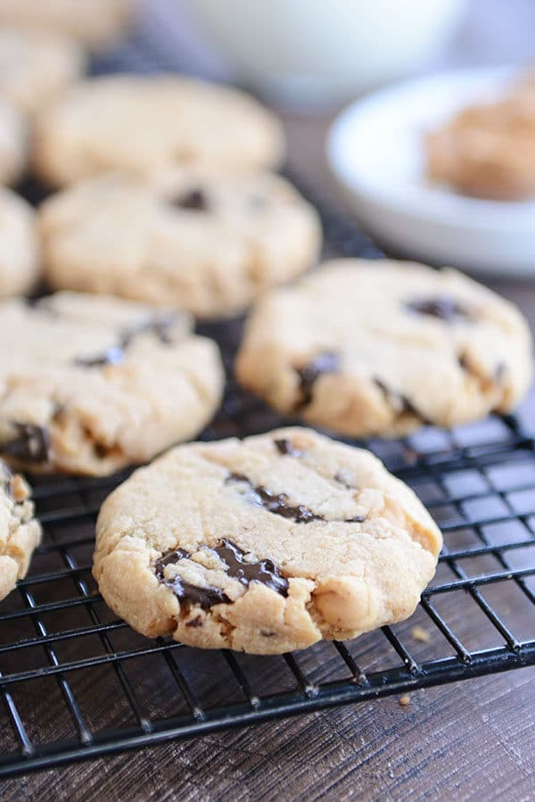Peanut butter chocolate chip cookies on a metal cooling rack.