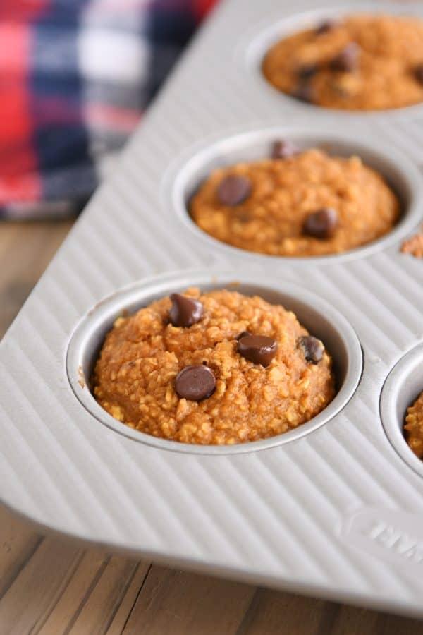 Easy pumpkin blender muffins baked in muffin tin.