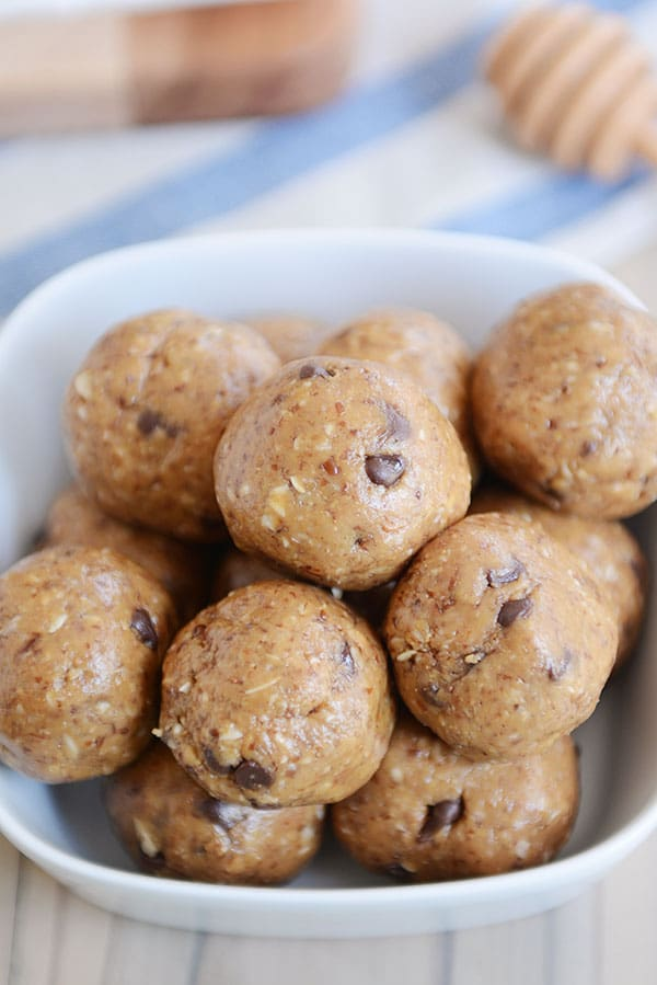 A bowl full of chocolate chip protein bites.