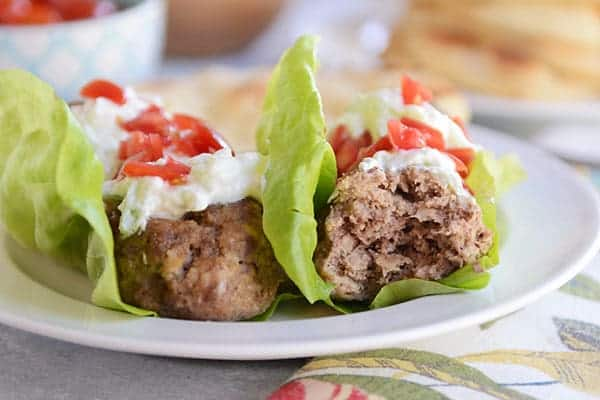 Falafel meatballs! Wrapped up in lettuce (or naan!) and smothered in tzatziki sauce. Yum! width=