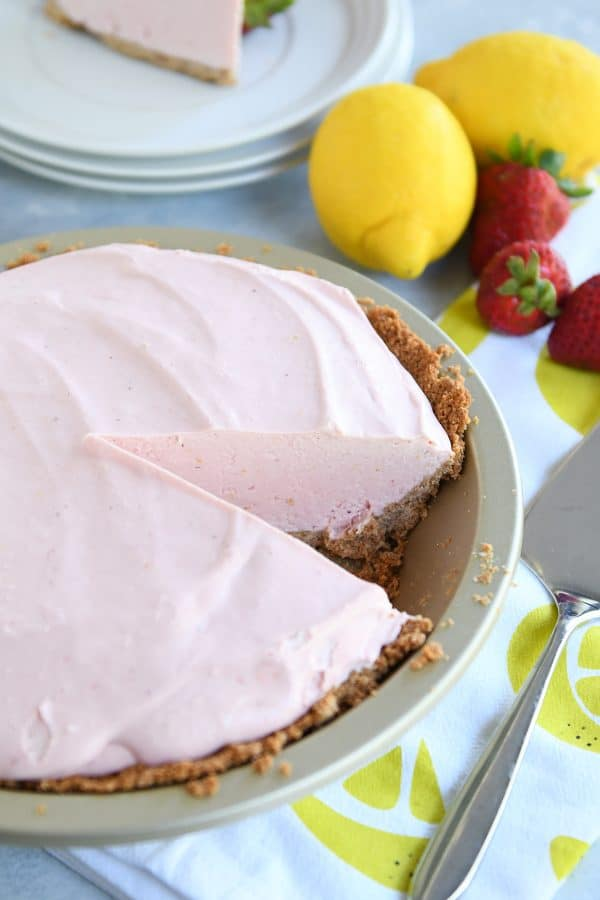 Strawberry lemonade pie with slice taken out.