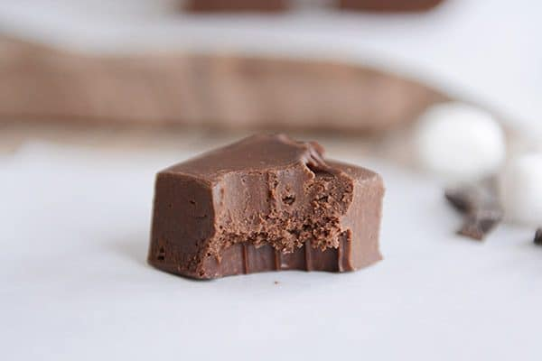 A square of fudge with one bite taken out.