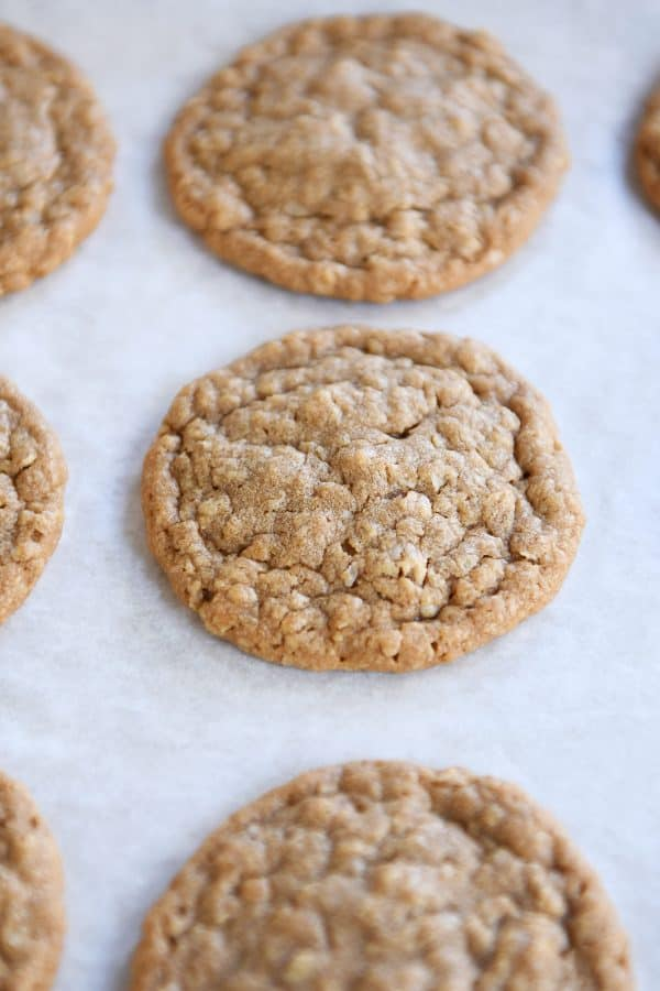 Gingerbread oatmeal cookies on parchment paper.