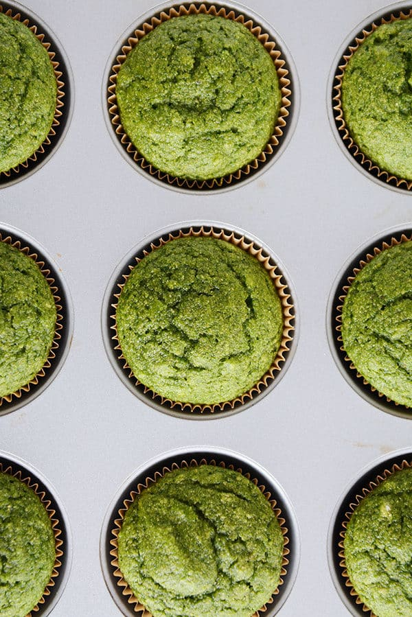 top view of cooked green muffins in a muffin tin