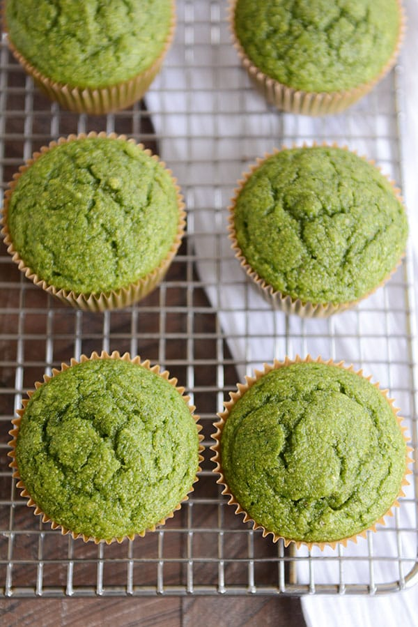 top view of baked green muffins on a cooling rack