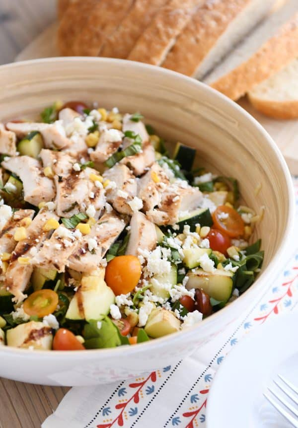 Grilled chicken orzo salad in white serving bowl.