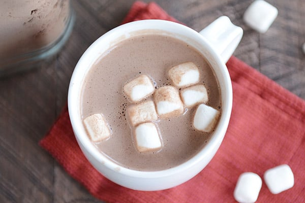 top view of a white mug of hot chocolate and mini marshmallows
