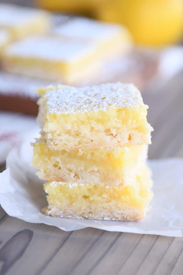 Three lemon bars stacked on top of each other.