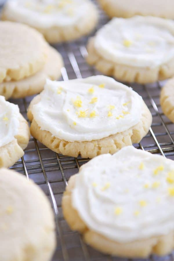 Frosted lemon swig sugar cookies on wire cooling rack.
