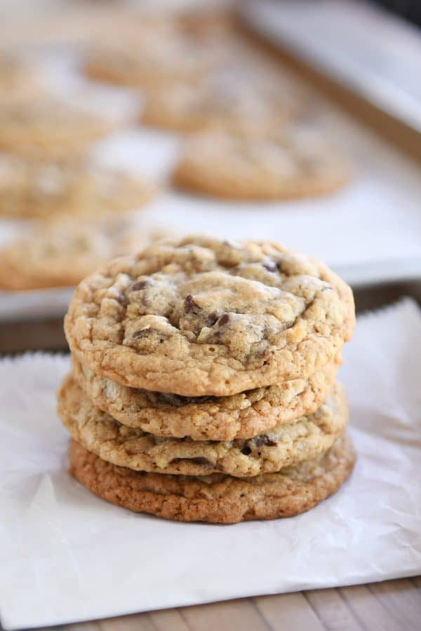 Stack of soft and chewy oatmeal chocolate chip coconut cookies.