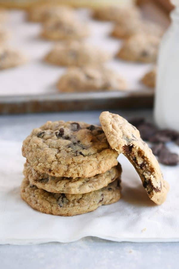 Oatmeal chocolate chip cookies on white napkin.