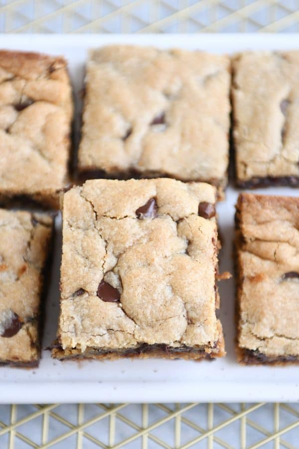 Top down view of white tray of peanut butter chocolate chip bars.