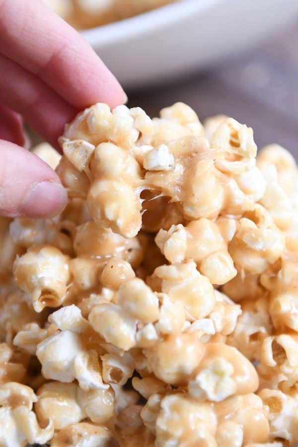 Pulling off a piece of peanut butter caramel popcorn.