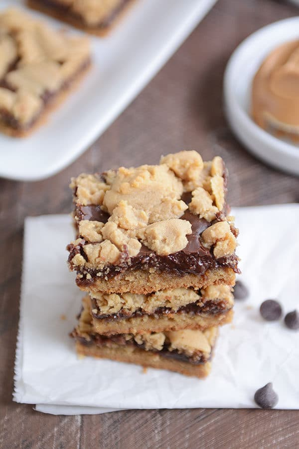 Top down view of three peanut butter fudge bars stacked on top of each other.
