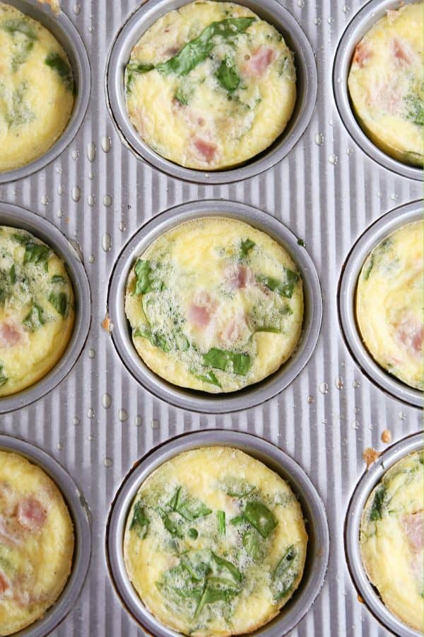 Healthy egg and veggie muffins in muffin tin.