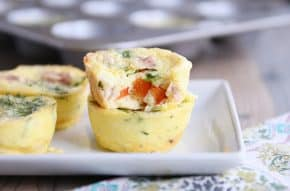 Bite out of healthy egg and veggie muffin.