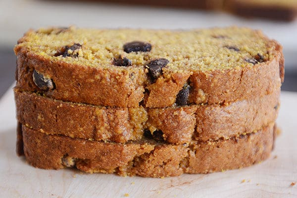 Three slices of pumpkin chocolate chip bread stacked on top of each other.