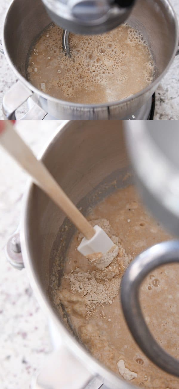water and yeast getting mixed into a KitchenAid bowl of whole wheat bread dough
