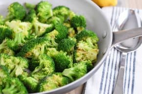 Skillet with roasted broccoli.