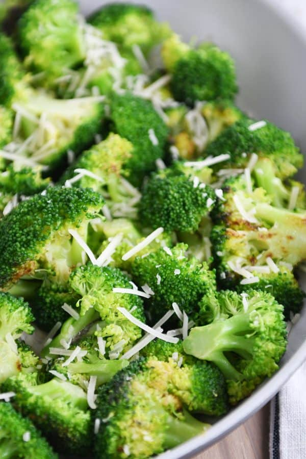 Skillet with broccoli and Parmesan cheese.