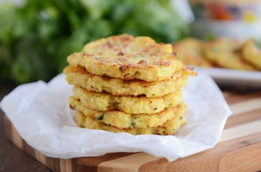These delicious little spaghetti squash fritters are going to rock your world! Baked, not fried, they are loaded with Parmesan flavor and are so easy to make!