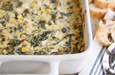 Spinach artichoke dip in white pan.