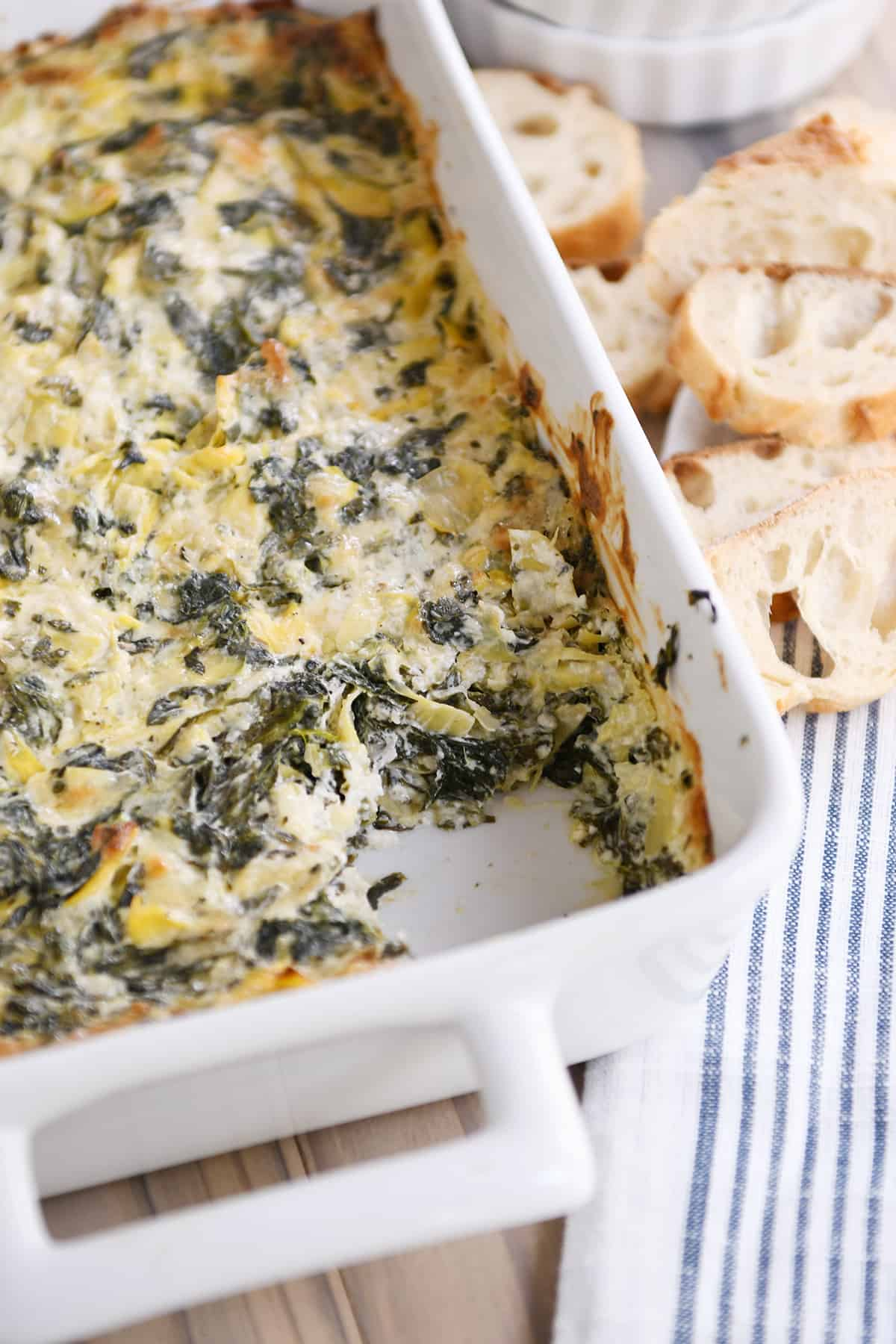 White pan with the best spinach artichoke dip.