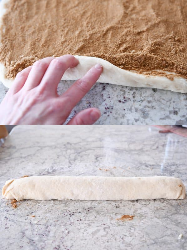 Rolling up cinnamon roll dough.