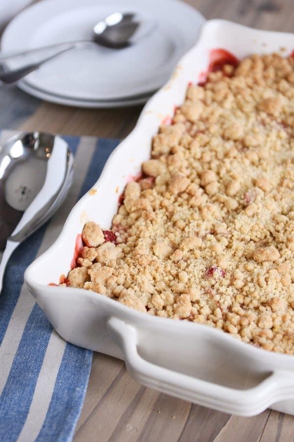 Strawberry rhubarb crumble topping in white baking pan.