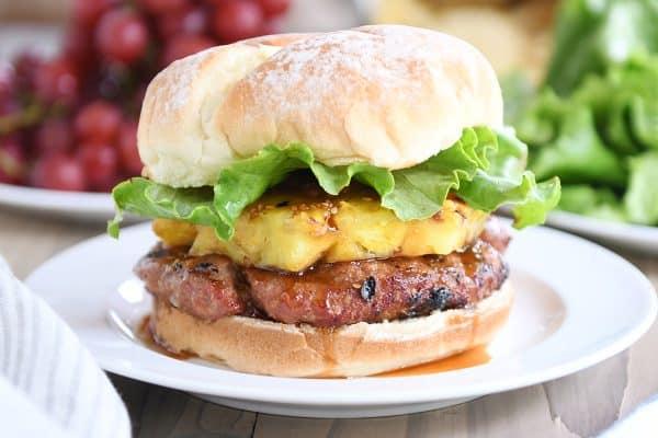 Teriyaki turkey burgers with grilled pineapple, lettuce, and soft bun.