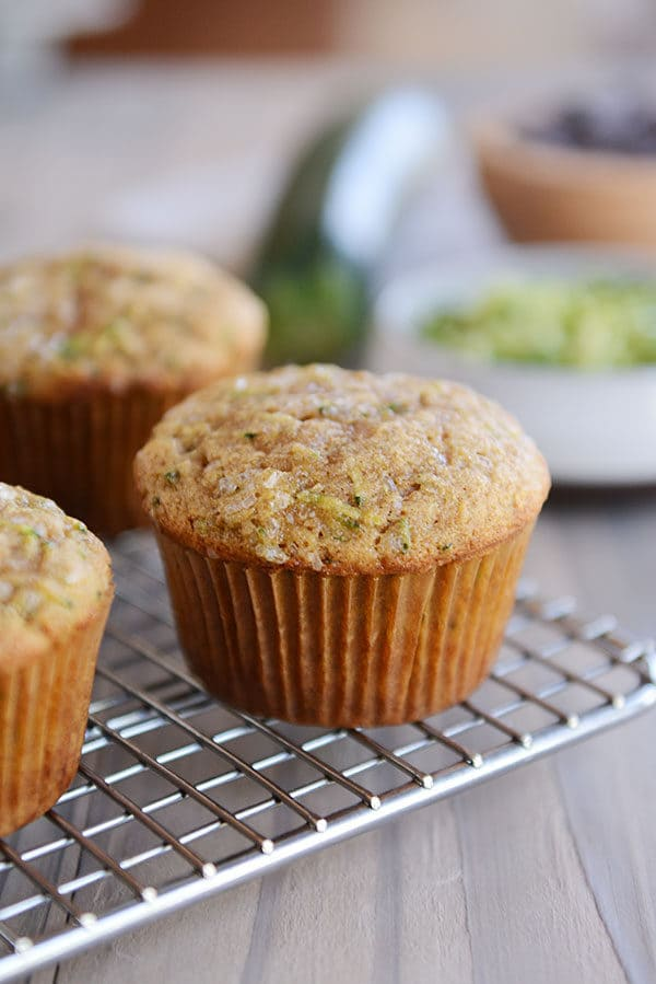 Cooked zucchini muffins on a cooling rack.