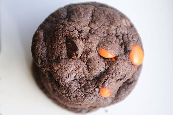 Top view of a stack of chocolate M&M cookies.