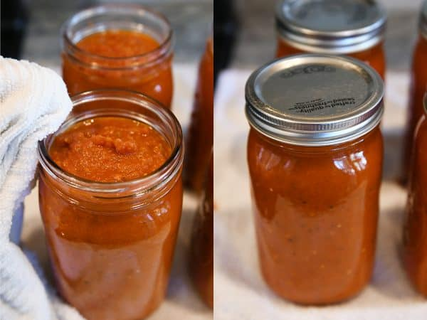 Wiping edge of jar and putting on lids and rings for homemade canned spaghetti sauce recipe.
